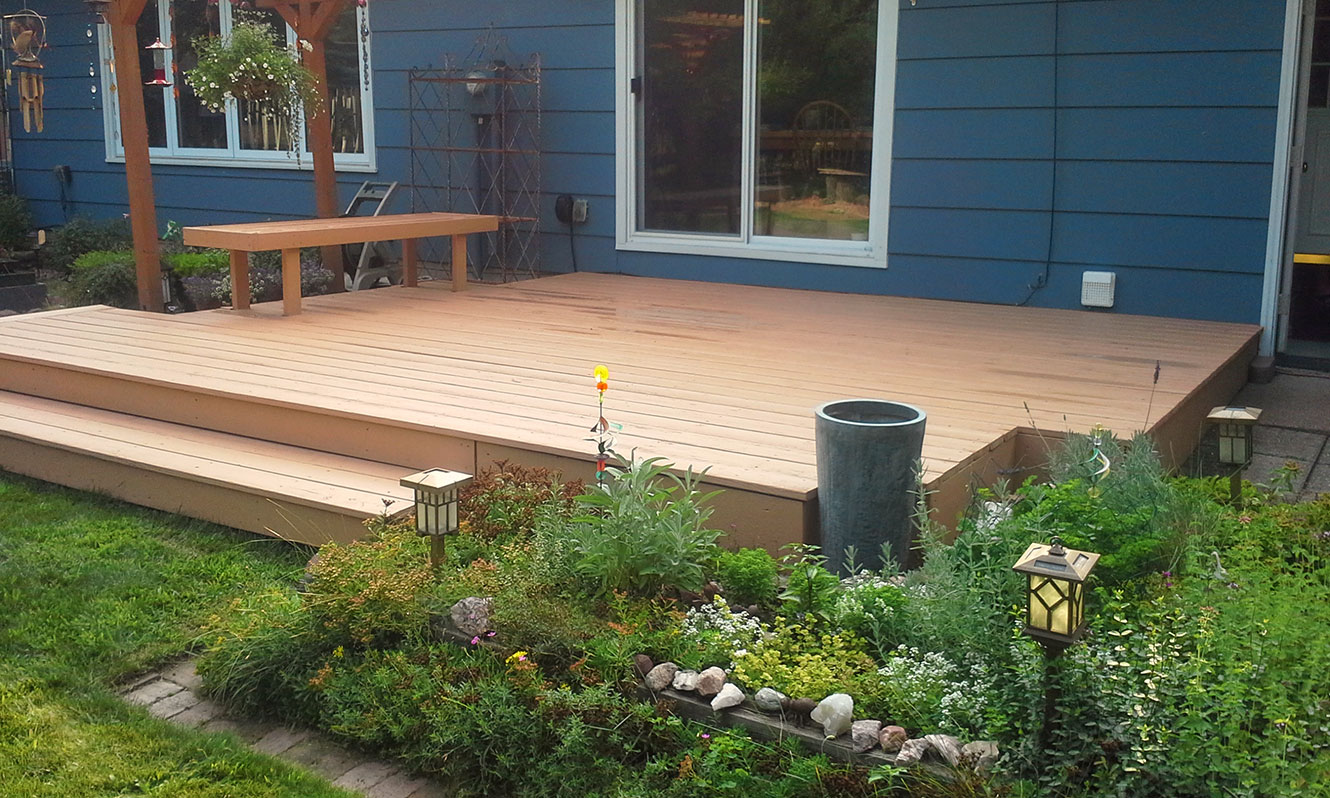 deck--brushmasters-brown-beside-blue-house.jpg